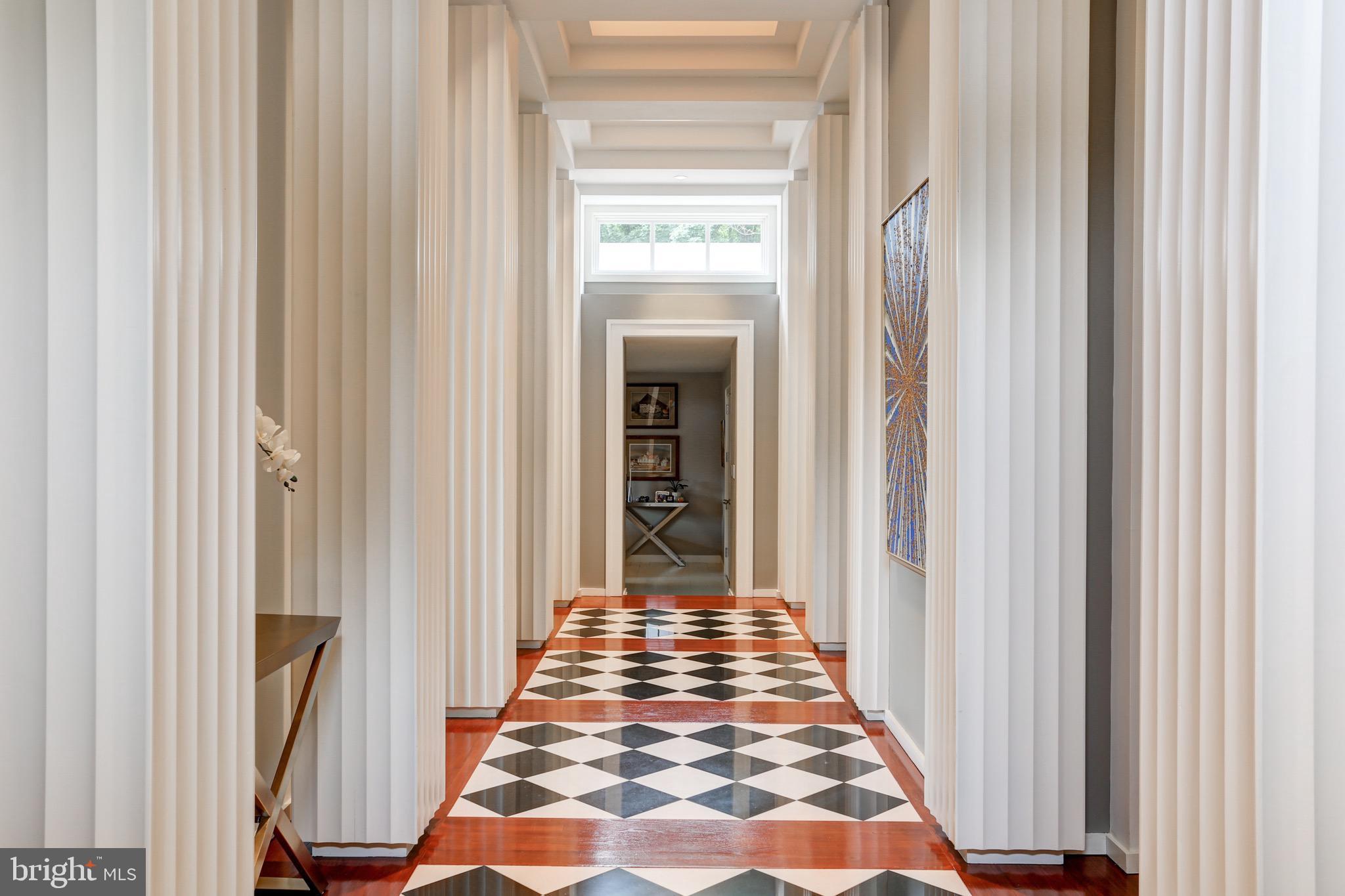 View through main hallway to family room/ kitchen