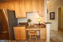 Built-in desk area in kitchen - 47429 RIVER FALLS DR, STERLING