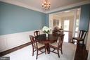 Formal dining room w/chair rail and crown molding - 47429 RIVER FALLS DR, STERLING