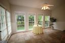 Sun room opens to brick patio and fenced rear yard - 47429 RIVER FALLS DR, STERLING
