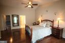 Gleaming hardwood floor in master bedroom - 47429 RIVER FALLS DR, STERLING