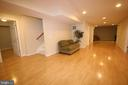 Basement recreation room w/ engineered wood floor - 47429 RIVER FALLS DR, STERLING