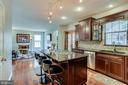 Kitchen opens to family room - 43221 DARKWOODS ST, CHANTILLY
