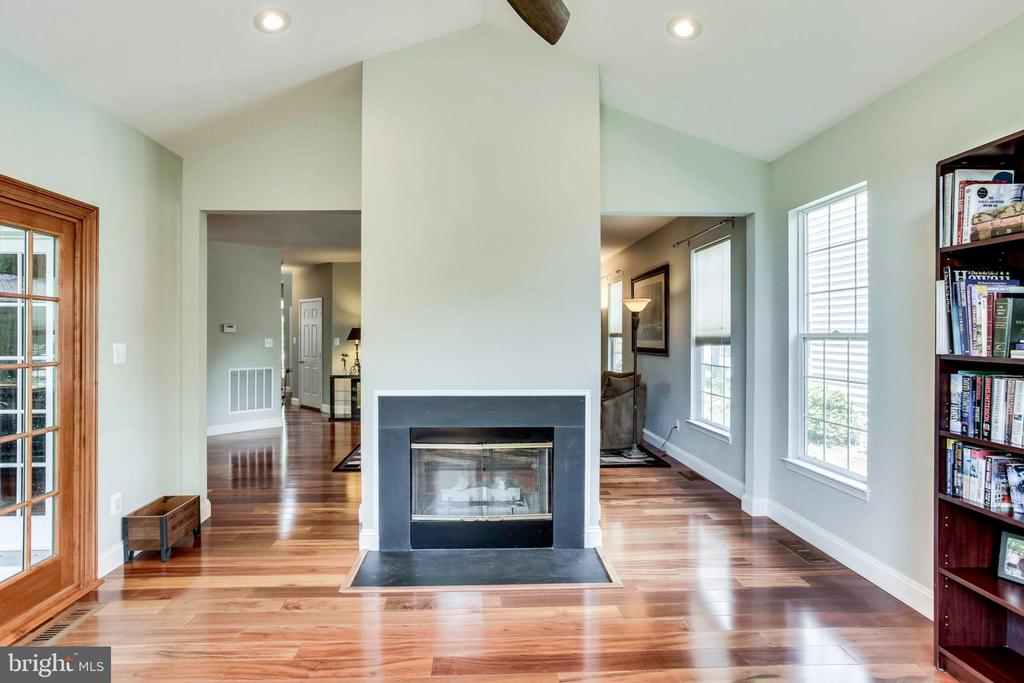 Sunroom with pass through fireplace - 43221 DARKWOODS ST, CHANTILLY