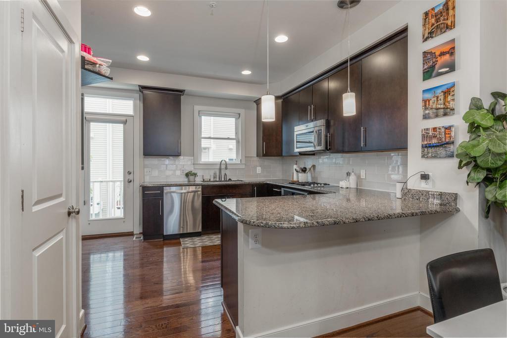 Kitchen with custom Porcelanoso tile backsplash - 3049 CHANCELLORS WAY NE, WASHINGTON