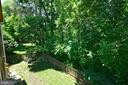 The rear yard backs to lush green trees - 416 LAWFORD DR SW, LEESBURG