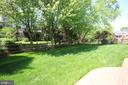 View of fenced back yard from patio - 47429 RIVER FALLS DR, STERLING