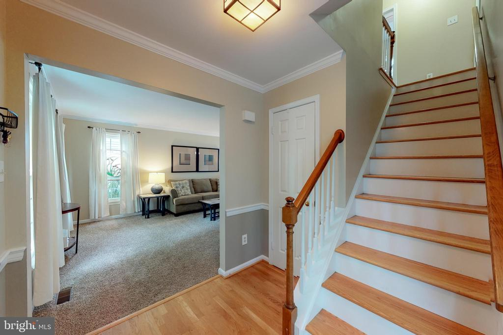 Wood floors in foyer and newer wood steps to upper - 11707 OLD BAYBERRY LN, RESTON