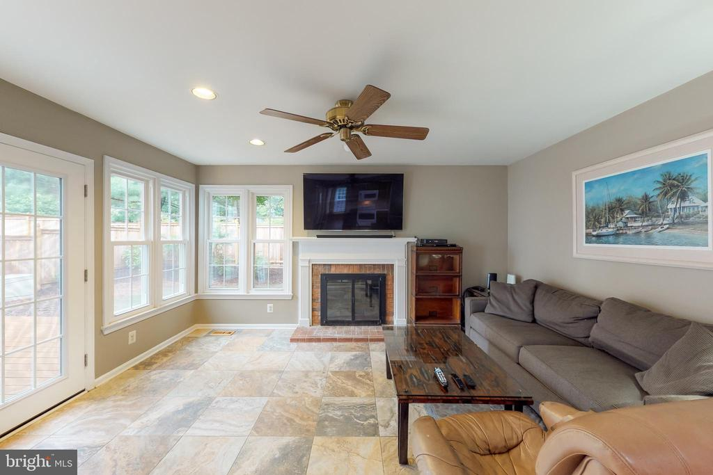 Newer stone tile floors in this serene space - 11707 OLD BAYBERRY LN, RESTON
