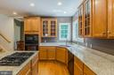 Featuring glass front cabinetry, good counterspace - 4524 MOSSER MILL CT, WOODBRIDGE