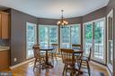 Breakfast Room w Window Wall and Hardwood Flooring - 4524 MOSSER MILL CT, WOODBRIDGE