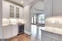 Butler's pantry with wet sink & wine fridge. - 2015 ARLINGTON RIDGE RD, ARLINGTON