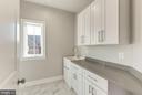 Upper level laundry w/marble and built ins. - 2015 ARLINGTON RIDGE RD, ARLINGTON