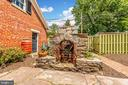 Stone outdoor fireplace to cozy up to and enjoy - 203 ROCKWELL TER, FREDERICK
