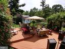 large deck in back off sunroom... - 8607 LAWS DR, MANASSAS