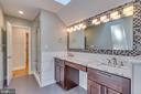 Double vanities w extensive tile work - 16332 HAMPTON RD, HAMILTON