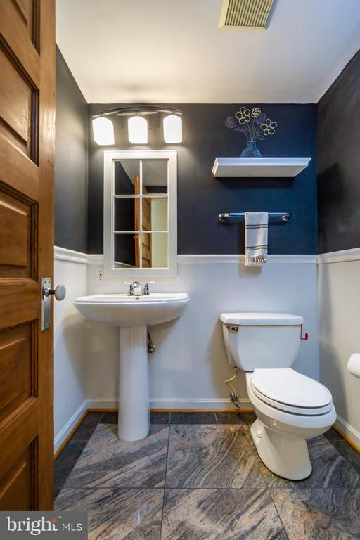 Main lvl 1/2 bath w/ granite flr + chalkboard wall - 5912 ONE PENNY DR, FAIRFAX STATION