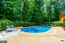 Tiered yard w/ feature stone wall at rear of photo - 5912 ONE PENNY DR, FAIRFAX STATION