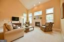 Cozy up by the main level fireplace - 21470 BASIL CT, BROADLANDS