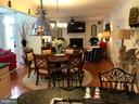 Family room w/fireplace, opens off kitchen - 504 CREEK CROSSING LN, GLEN BURNIE