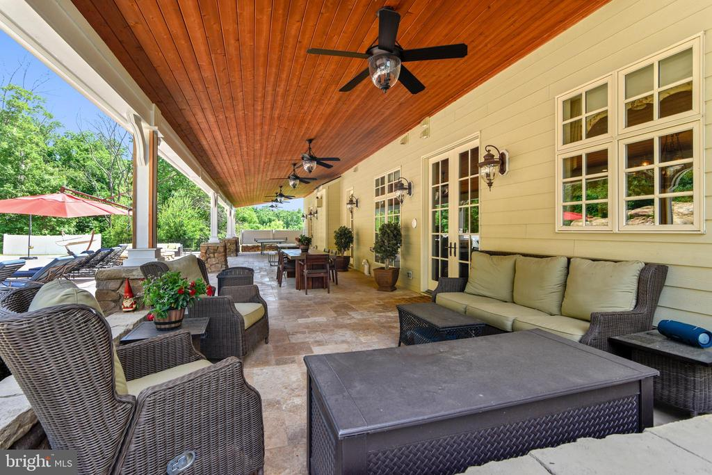 Deep veranda for poolside relaxing - 14416 LOYALTY RD, LEESBURG