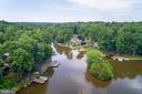 AERIAL VIEW OF HOME FROM THE WATER - 100 HARBOURVIEW DR, LOCUST GROVE