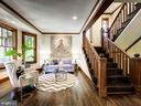 Inviting living room framed by gorgeous staircase - 4412 WALSH ST, CHEVY CHASE
