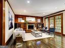 Family room with wood-burning fireplace - 4412 WALSH ST, CHEVY CHASE