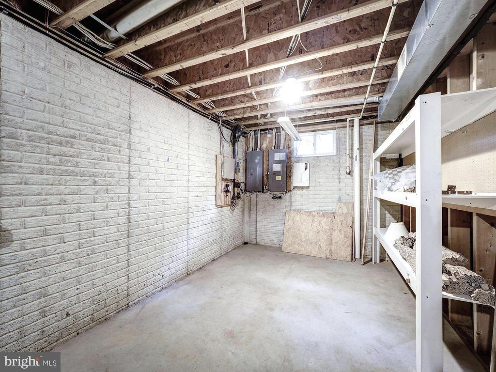 Lower level storage room with shelving - 4412 WALSH ST, CHEVY CHASE