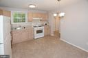 Kitchen with space for breakfast table. - 8233 MCNEIL ST, VIENNA