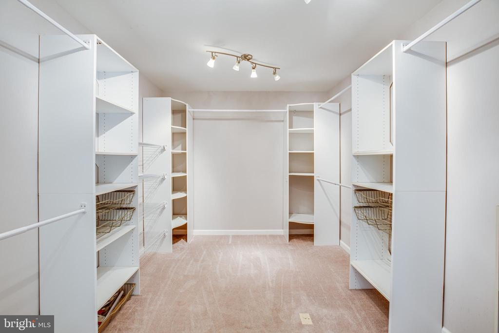 Walk-in master closet with custom shelving - 13304 BROOKCREST CT, FREDERICKSBURG