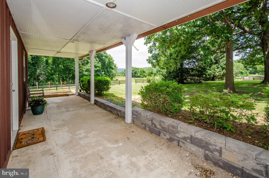 Covered Porch has quiet views of fields - 20659 FURR RD, ROUND HILL