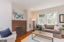 Cozy up to the fireplace on a snow day. - 3922 20TH ST NE, WASHINGTON