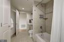 Guest bathroom -- travertine floors/walls - 2301 CHAMPLAIN ST NW #305, WASHINGTON