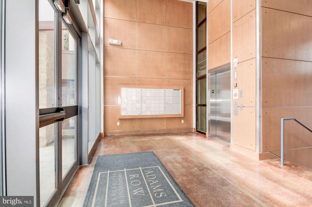 Lobby with mail slots and elevator - 2301 CHAMPLAIN ST NW #305, WASHINGTON