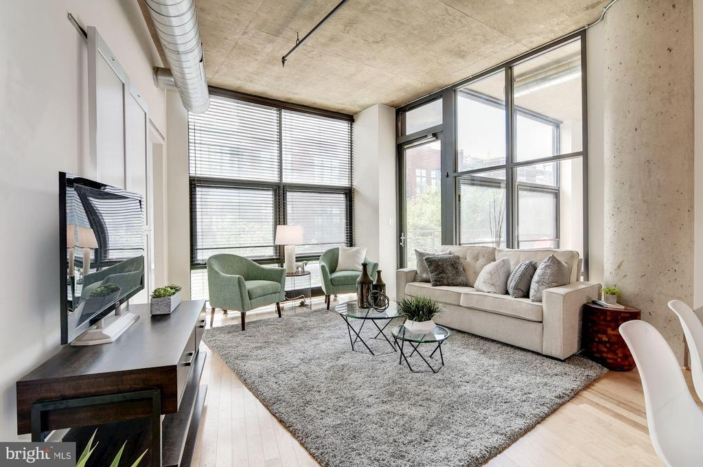 Living room w/ floor to ceiling windows - 2301 CHAMPLAIN ST NW #305, WASHINGTON