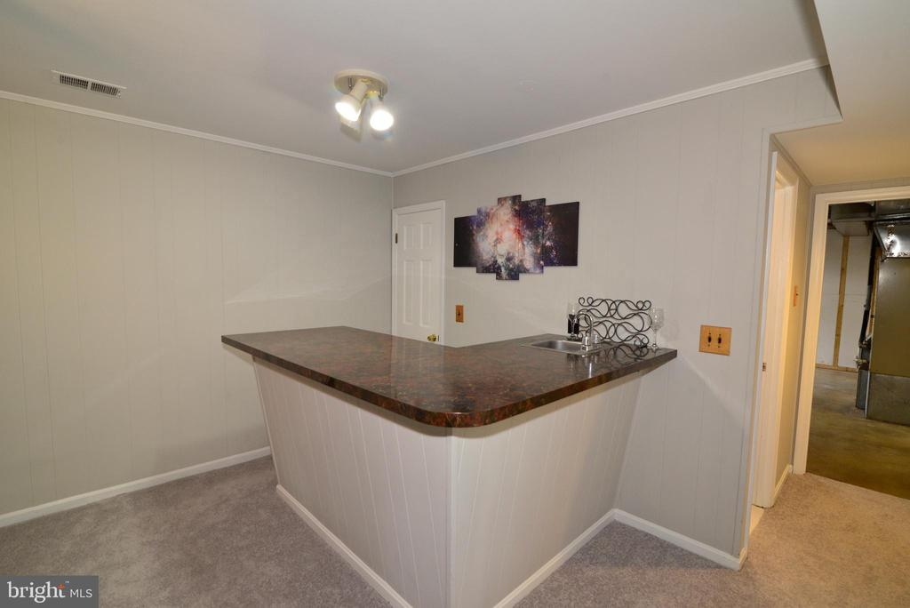 Wet bar in Lower Level - 104 COUNTRY CLUB DR SW, LEESBURG