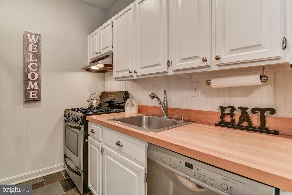 Kitchen with butcher block counters - 4114 DAVIS PL NW #4, WASHINGTON
