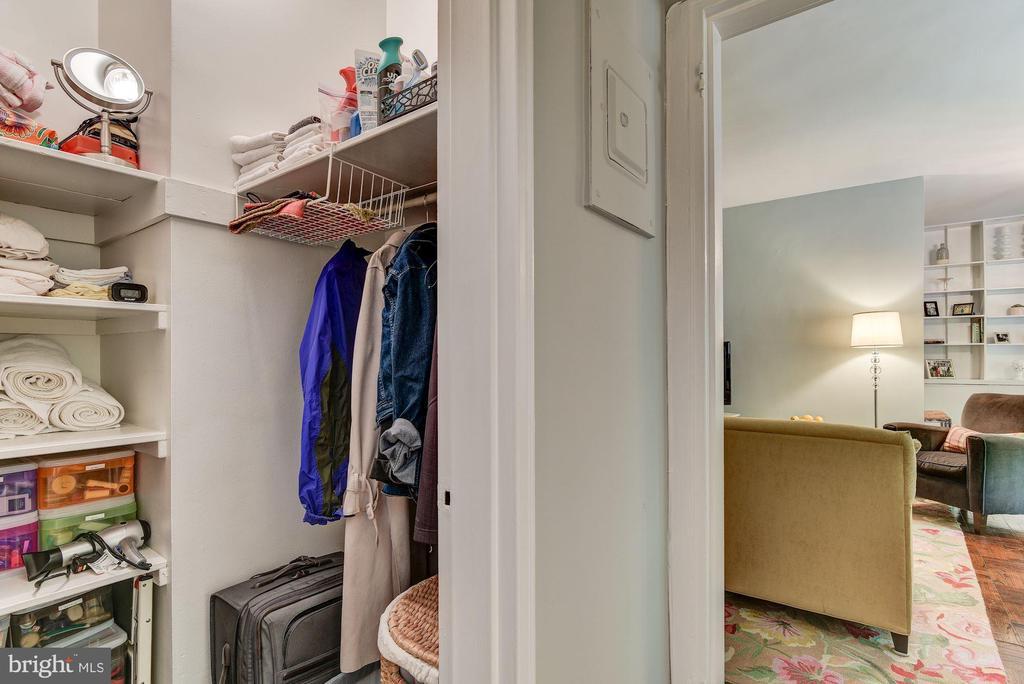 Huge hall closet with shelving and hanging rods - 4114 DAVIS PL NW #4, WASHINGTON