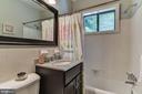 Full bath with white porcelain tile - 4114 DAVIS PL NW #4, WASHINGTON
