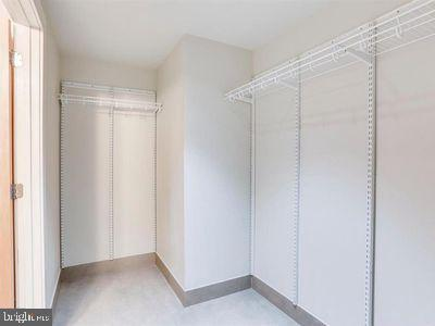 walk in main closet adjustable racks - 1133 14TH ST NW #1006, WASHINGTON