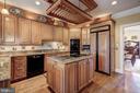Kitchen Open to Formal Dining - 4309 SUNDOWN RD, GAITHERSBURG