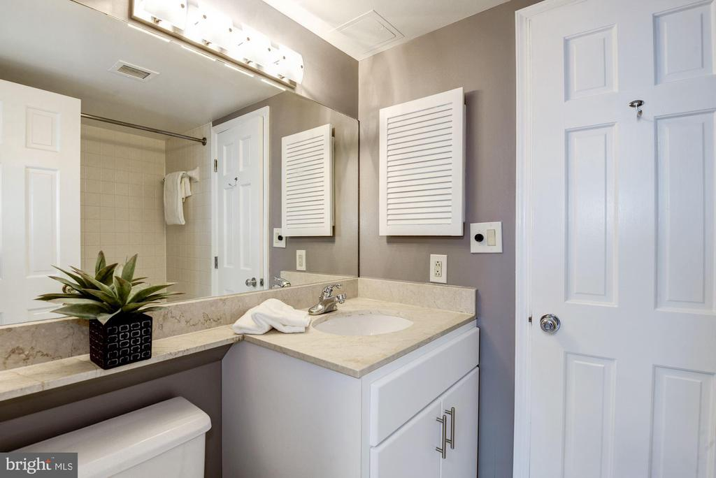 Updated bathroom with lots of light - 801 PENNSYLVANIA AVE NW #1207, WASHINGTON