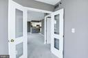 Kitchen view through the double doors of the den - 801 PENNSYLVANIA AVE NW #1207, WASHINGTON