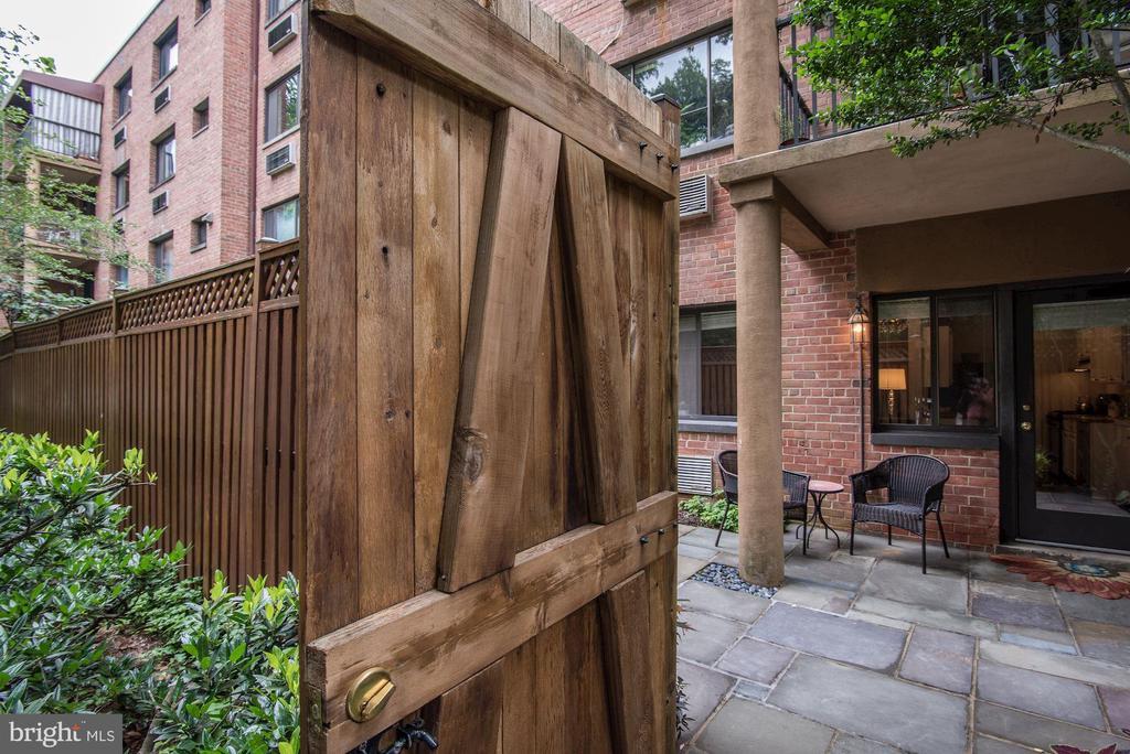 Gate to apt door - 4114 DAVIS PL NW #4, WASHINGTON