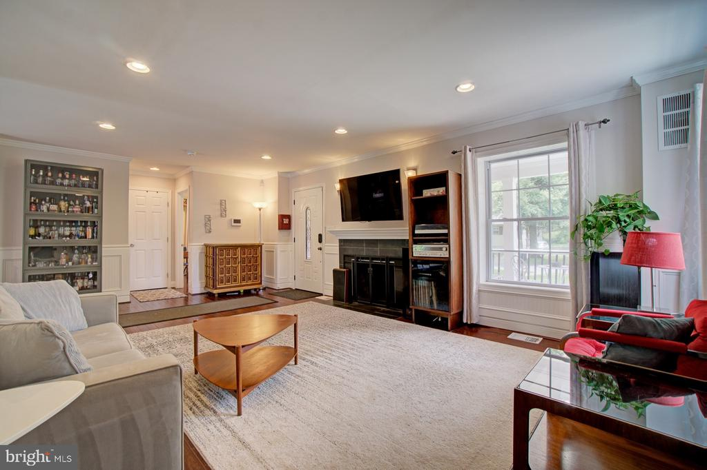 View of living area from stairwell to upper level - 4802 LONGFELLOW ST, RIVERDALE