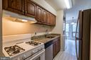 Kitchen with Granite Counters - 11208 CHESTNUT GROVE SQ #212, RESTON