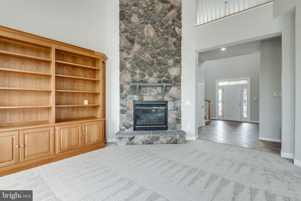 Stone fireplace is a great focal point - 43725 COLLETT MILL CT, LEESBURG