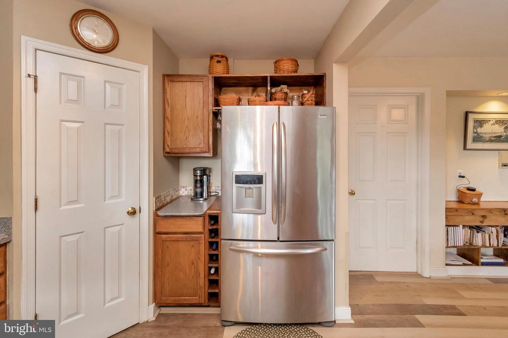 Door from laundry rm into kitchen w/view to FamRm - 7329 CLOVERHILL RD, SPOTSYLVANIA