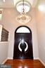 Foyer open to  grand chandelier and oval window - 120 KINGSLEY RD SW, VIENNA